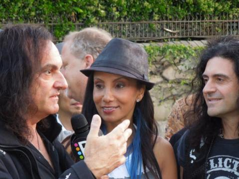 "Vinny Appice (Black Sabbath and Dio) & Phil Soussan (Billy Idol and Osbourne) being interviewed by gal from ""E"""